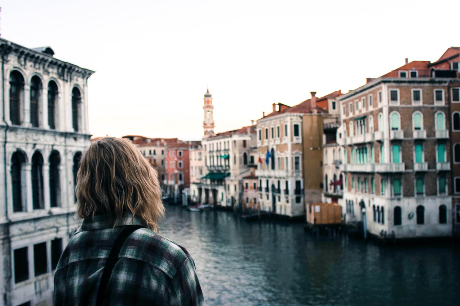 Woman overlooking Venice canal