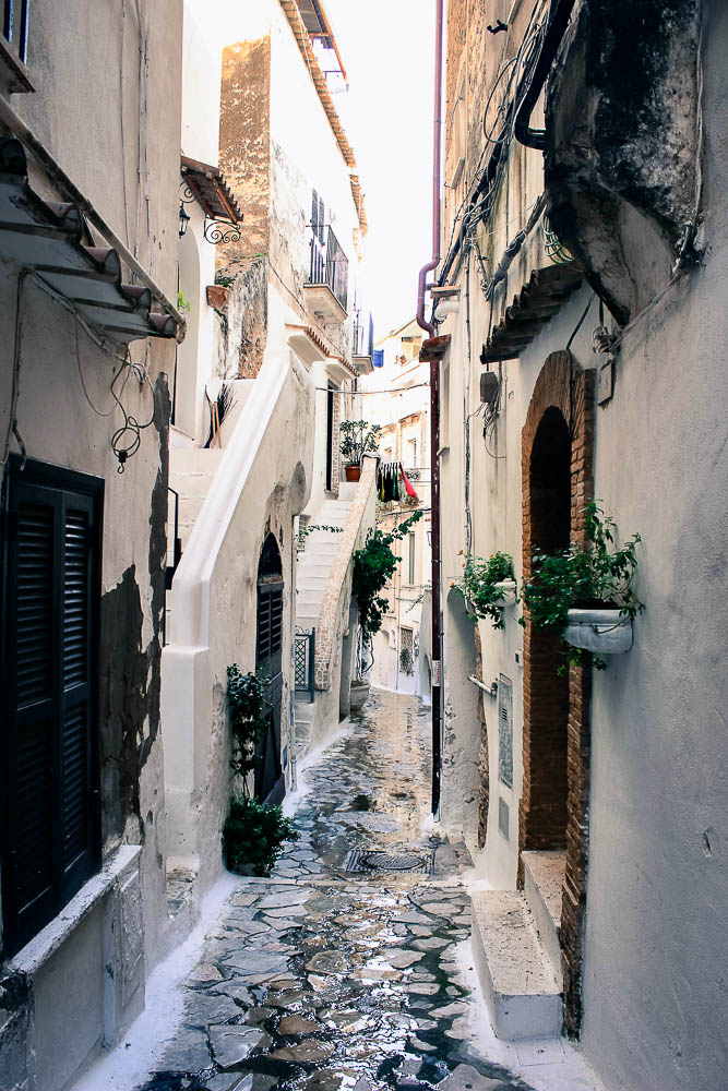 Water running down alleyway