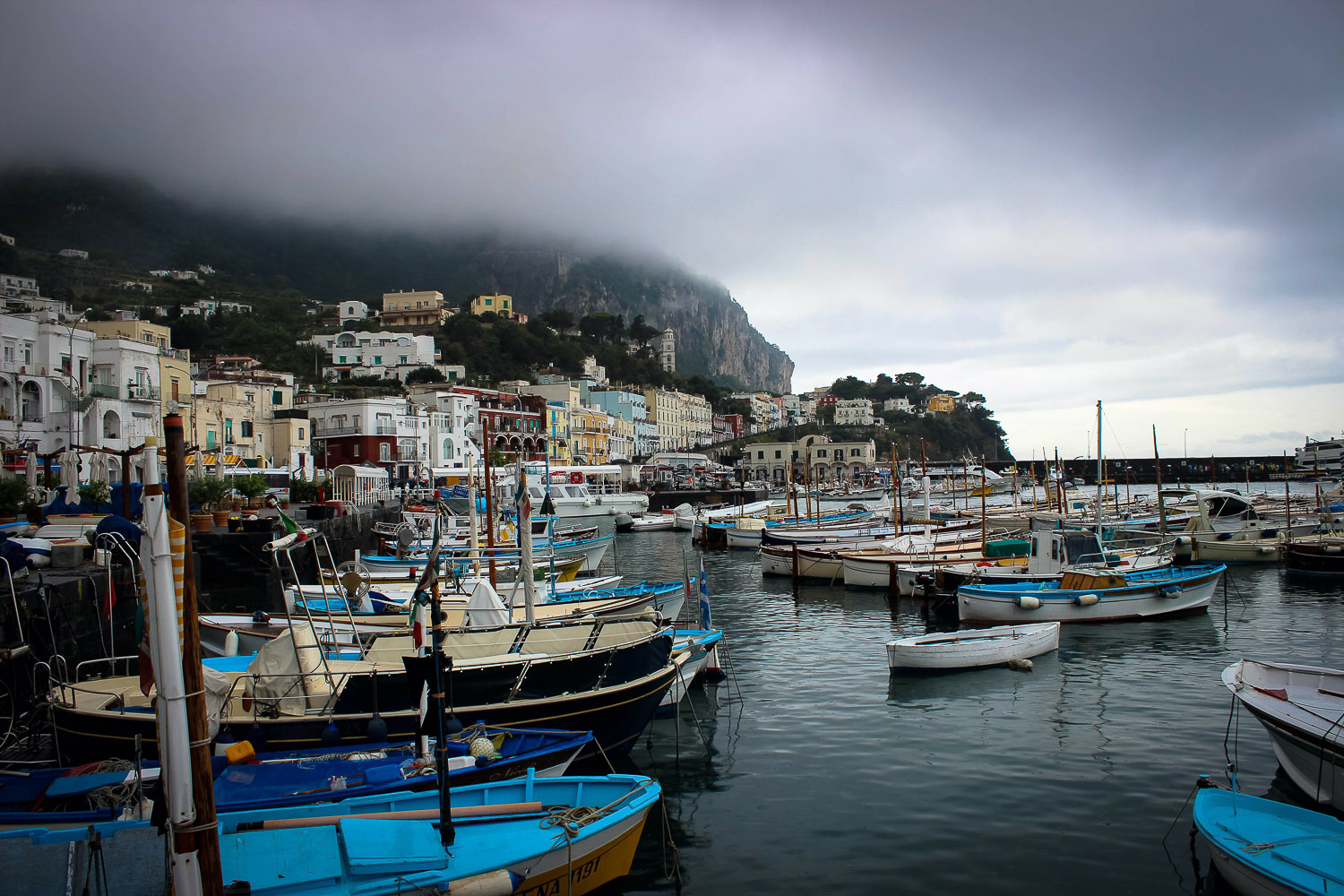 Boats in bay on stormy day