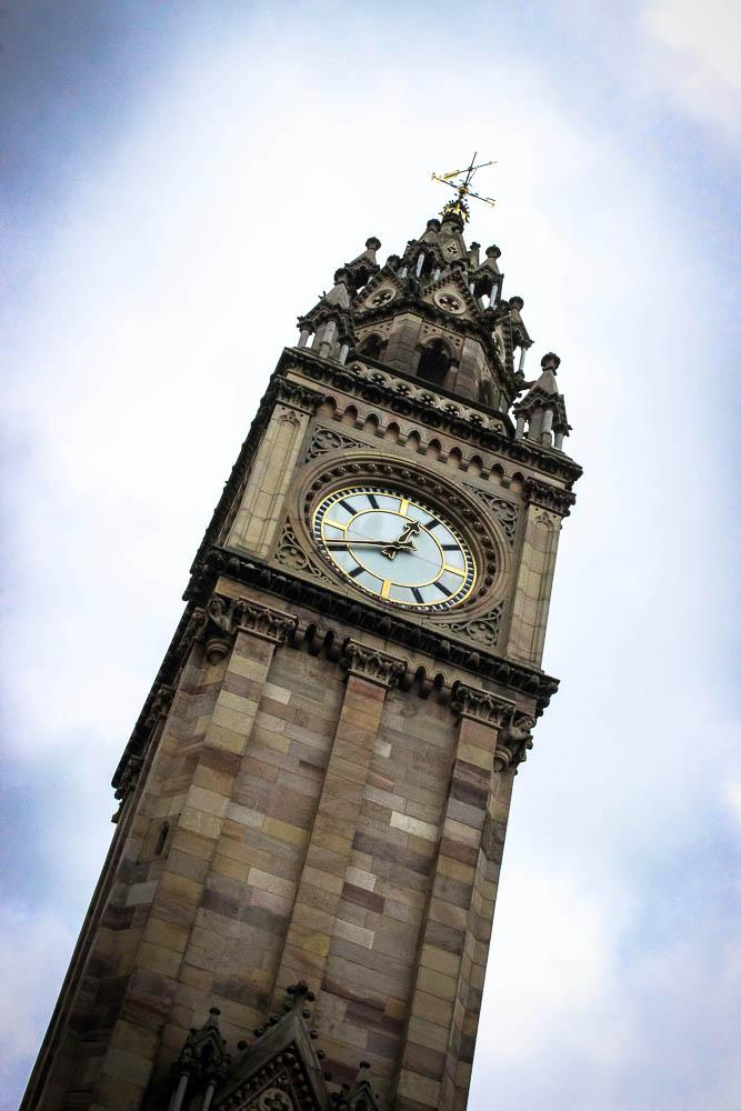Clock tower against gray sky