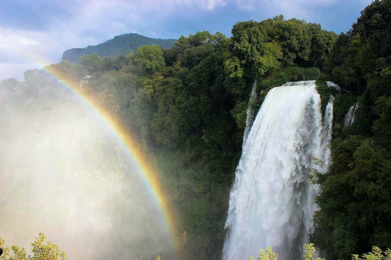 Rainbow next to waterfall